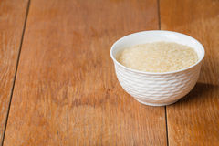 Uncooked rice in white bowl Stock Photo