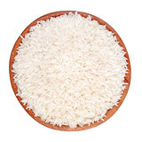 Uncooked rice in a wooden bowl on a white background Royalty Free Stock Image