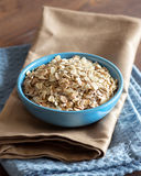 Uncooked rolled oats in a bowl Royalty Free Stock Photography