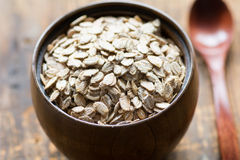 Uncooked rolled oats in wooden bowl Royalty Free Stock Image