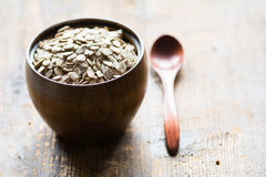 Uncooked rolled oats in wooden bowl Stock Image