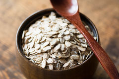 Uncooked rolled oats in wooden bowl Royalty Free Stock Photography