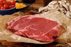 Uncooked round steak Stock Image