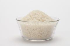 Uncooked ryż w pucharze z… Obrazy Royalty Free