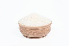 Uncooked ryż w naczyniu Fotografia Royalty Free