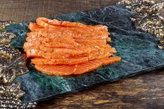Uncooked salmon fish fillet on marble plate, top view ready to eat. Uncooked salmon fish fillet with marble plate, top view ready to eat snack healthy ingredient royalty free stock photo