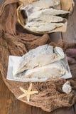 Uncooked salted cod on fishing nets Stock Image