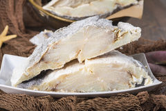 Uncooked salted cod on fishing nets Stock Images