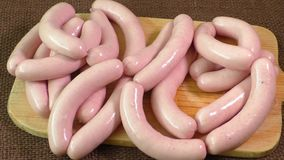 Uncooked sausage on the chopping board stock footage