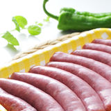Uncooked sausages. A pile of uncooked sausages in a plastic tray on a kitchen worktop Stock Images