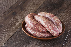 Uncooked sausages in a plate Royalty Free Stock Image