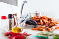 Uncooked seafood and  spices in  kitchen Royalty Free Stock Image