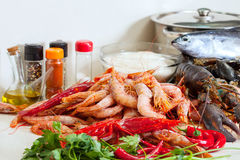 Uncooked  seafoods  in  kitchen. Still life with fresh uncooked  seafoods  in  kitchen Royalty Free Stock Photos