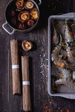 Uncooked Soba noodles and shrimps Royalty Free Stock Photo