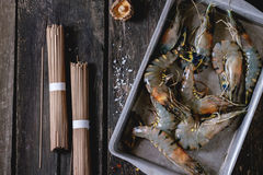 Uncooked Soba noodles and shrimps Stock Images