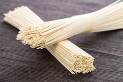 Uncooked Somen noodels. Dry, uncooked japanese somen noodles Royalty Free Stock Photography