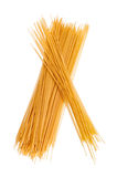 Uncooked spaghetti. Close-up on a white background Stock Photos