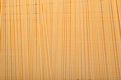 Uncooked spaghetti background Stock Photography