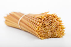 Uncooked spaghetti in a bundle Stock Images