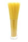 Uncooked spaghetti in glass Stock Photo