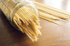 Uncooked spaghetti. In a jar of glass Stock Images