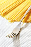 Uncooked spaghetti noodles Stock Photography