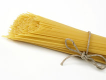 Uncooked spaghettis Stock Images