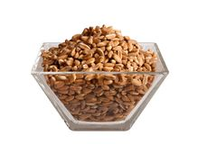 Uncooked Spelt in glass bowl, isolated Royalty Free Stock Photos