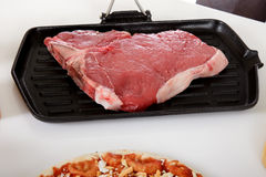 Uncooked steak on grill. Stock Photography