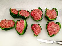 Uncooked Stuffed Peppers. Being prepped on a cutting board Royalty Free Stock Photography