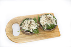 Uncooked Stuffed portabello mushrooms on wood board Stock Images