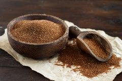 Uncooked teff grain in a bowl. With a spoon close up stock image