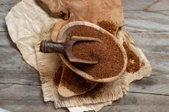 Uncooked teff grain in a bowl. With a spoon top view Stock Photo