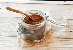 Uncooked  teff grain in a glass jar. With a spoon Royalty Free Stock Photos