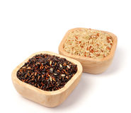 Uncooked thai black  rice in a wooden bowls Royalty Free Stock Images