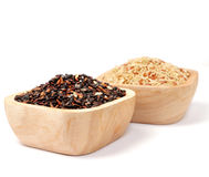 Uncooked thai black  rice in a wooden bowls Stock Photo