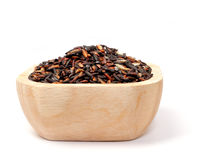 Uncooked thai black rice in a wooden bowls on white Royalty Free Stock Photography