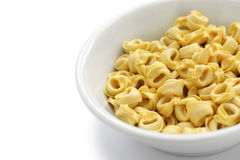 Uncooked tortellini pasta in bowl Royalty Free Stock Photography