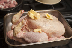 Uncooked turkey in a roasting pan Stock Photo