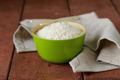 Uncooked white rice in a green bowl Royalty Free Stock Images