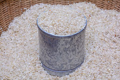 Uncooked white rice. One liter in bamboo basket Stock Images