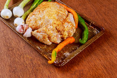 Uncooked whole chicken in baking form with chopped vegetables Stock Images