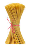 Uncooked Whole-Wheat Spaghetti Tied in Bundle Isolated on White Background. A bundle of ucooked whole-wheat spaghetti isolated on a white background Royalty Free Stock Photos