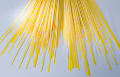 Uncooked yellow spaghetti stock image