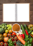 Uncookes brown milletl with vegetables and craft paper Stock Photography