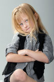 Uncooperative cute blond little girl Stock Images