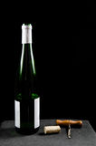 Uncorked wine bottle with utensiles Royalty Free Stock Photo