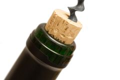 Uncorking a Wine Bottle (Close View). Corkscrew & wine bottle Royalty Free Stock Images