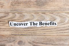 Uncover The Benefits text on paper. Word Uncover The Benefits on torn paper. Concept Image Royalty Free Stock Photos