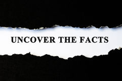 Uncover the facts concept. Phrase under torn paper Stock Photos